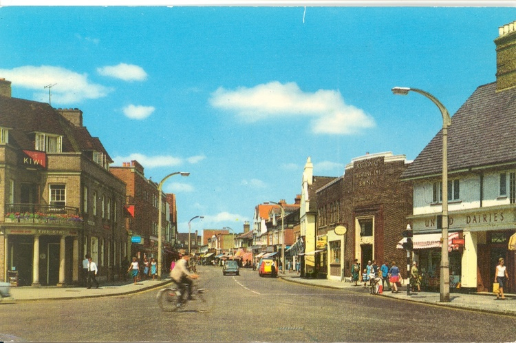 High st walton  looking from war memorial. shows kiwi pub. before dec 1972 when united dairies  right  closed down. 74.1973 2